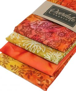 Orange and yellow batik fat quarters with floral designs.