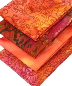 Orange and red batik fat quarter fabrics.