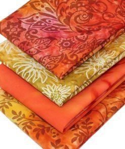 Orange and golden yellow batik fabrics.