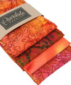 Batik fat quarters in orange, red and yellow.