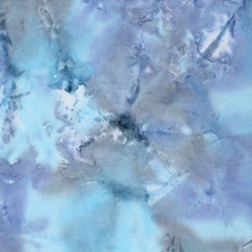 Light blue mottled batik fabric.