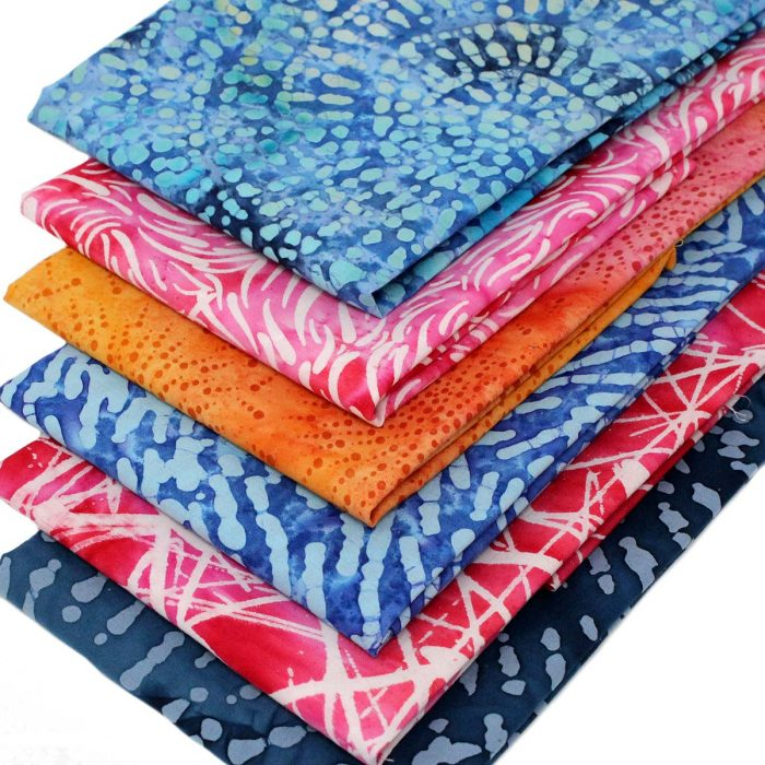 Batik fat quarter fabrics in rich blues, pinks and oranges.
