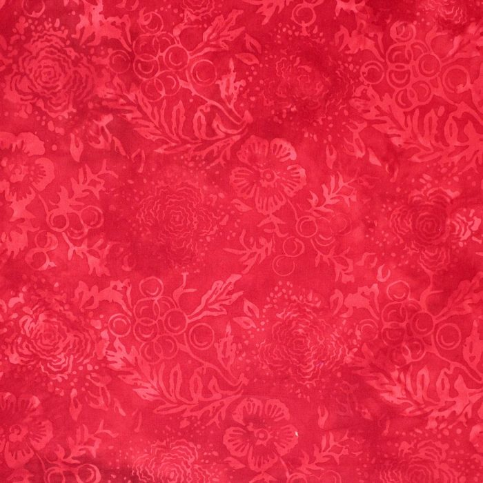 Fruit and flower batik fabric in red.