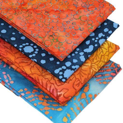 orange and blue batik fat quarters.