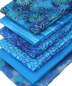 Blue fat quarter fabrics including batiks.