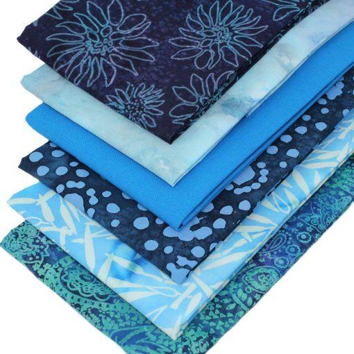 Batik fat quarter fabrics in shades of blue.