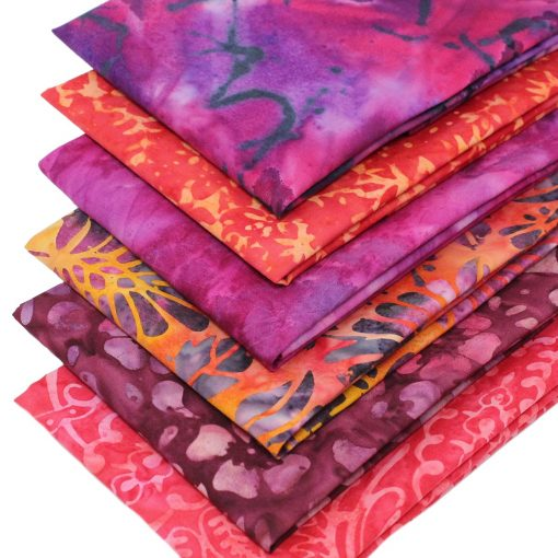 Bali batik fabrics in vibrant orange and pinks.