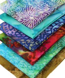 Batik fat quarter fabrics in blues, red, purple and green.