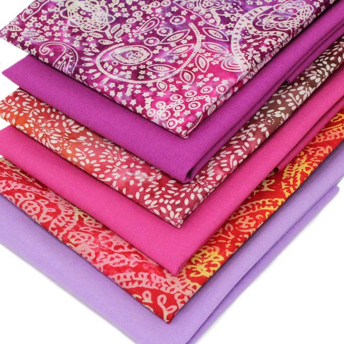 Fat quarter collection in orange, pink and lilac.