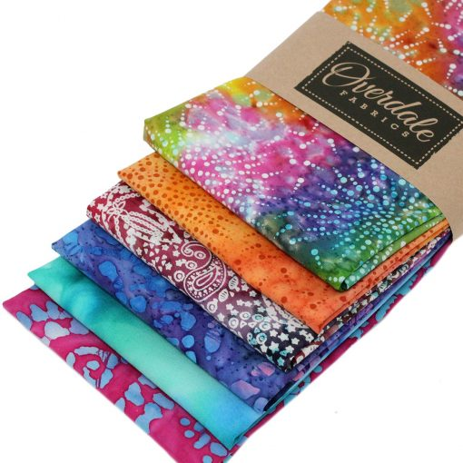 Batik fabrics in vibrant orange, pink, purple and green.