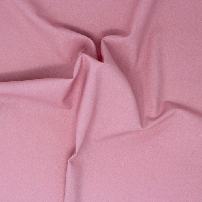Dusky rose plain solid fabric.
