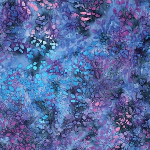 Purple, blue and lilac batik fabric with a droplet design.