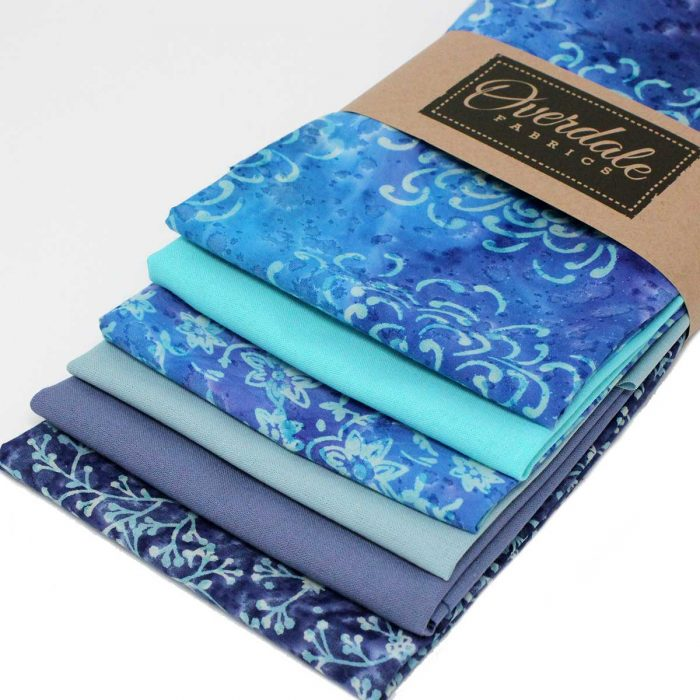 six fat quarter pack in shades of blue and grey.