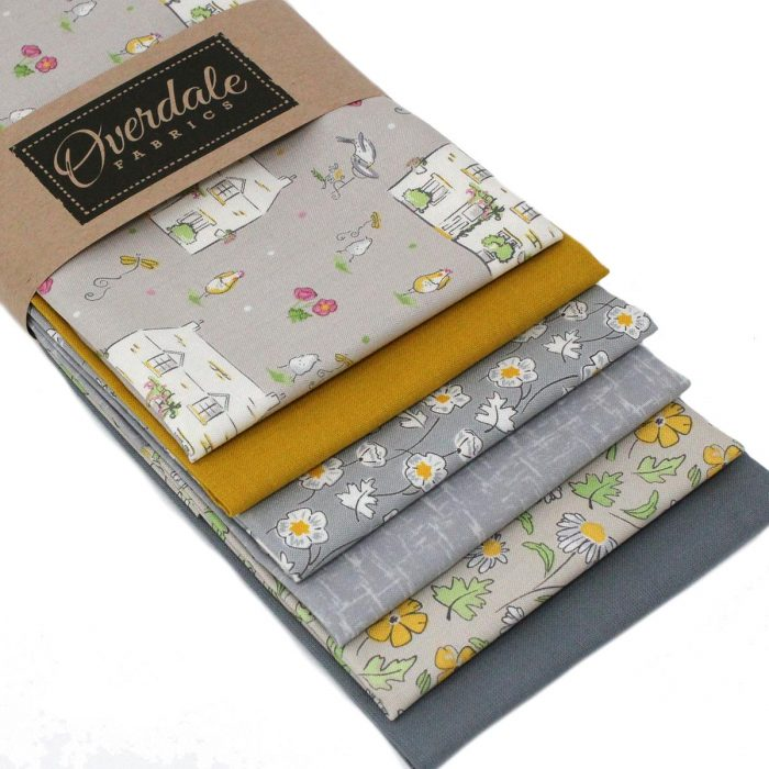 Fat quarter pack in grey and mustard yellow featuring a cottage garden theme.