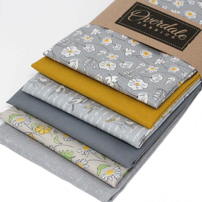 Grey and mustard fat quarter pack called Cottage Garden.