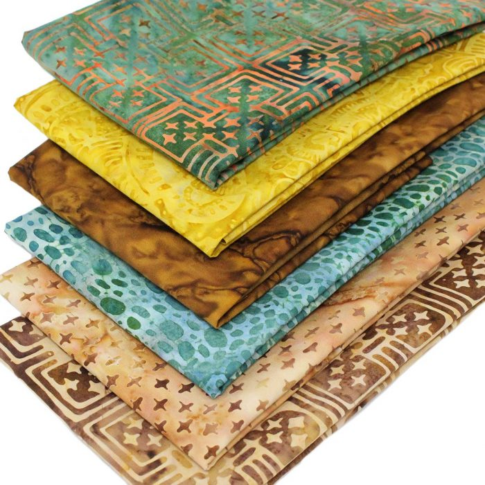 Bali batik fabrics in shades of green, yellow and brown.