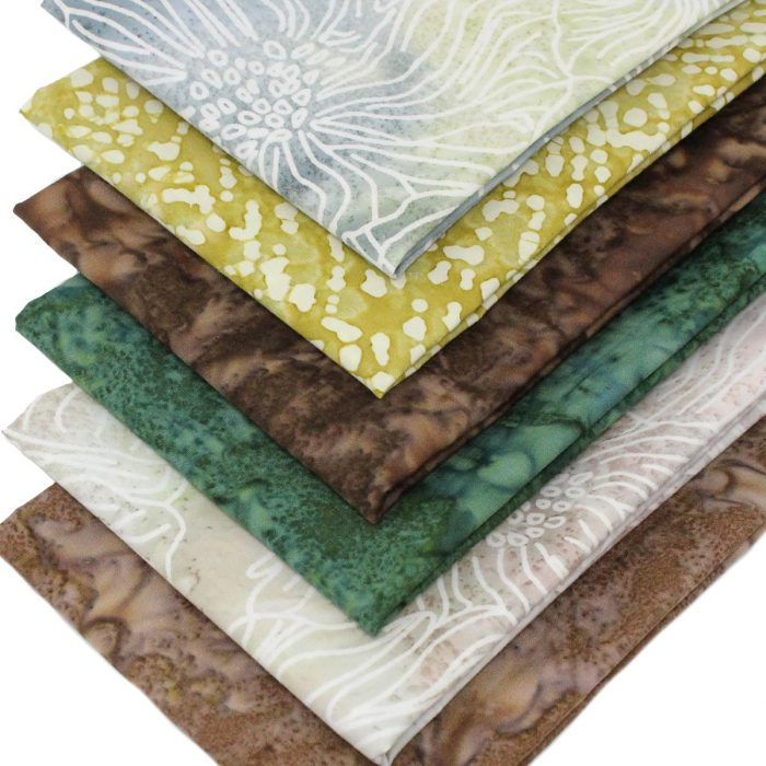 Batik fat quarters in shades of brown and green.