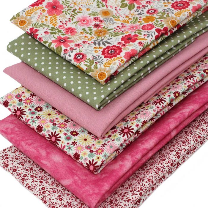 Fat quarter fabrics in pink florals and sage green.