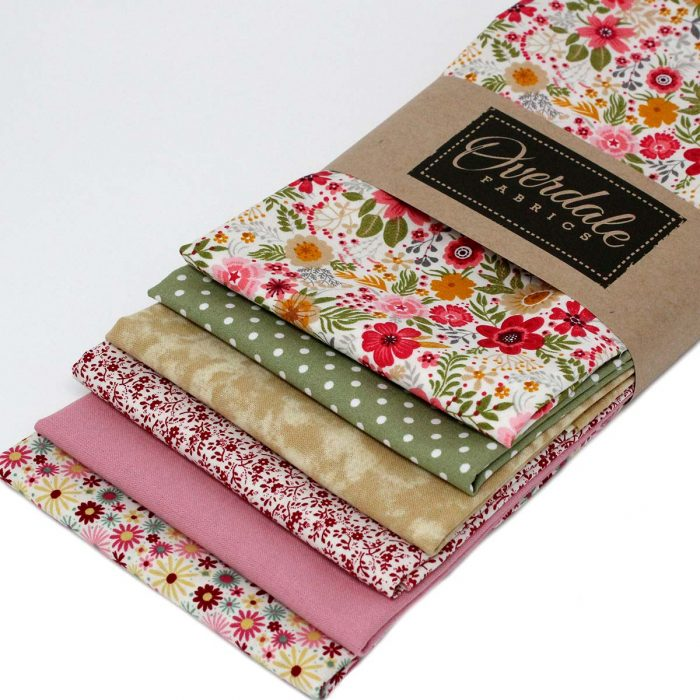 Red and green fabric bundle featuring flowers.