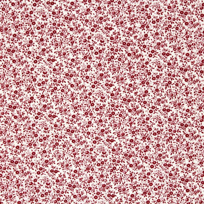 Small scale floral fabric print in red.