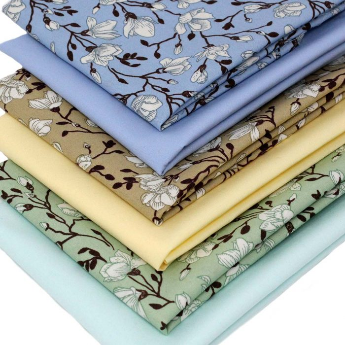 Printed fat quarter fabrics featuring a magnolia tree design.