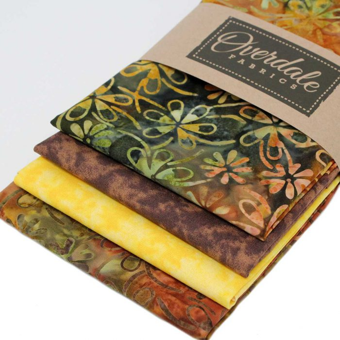 Four batik fat quarter pack in browns and yellows.