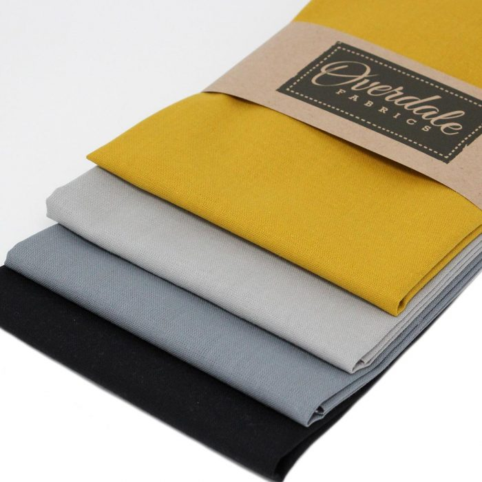 Plain solid fat quarter pack in yellow and grey.