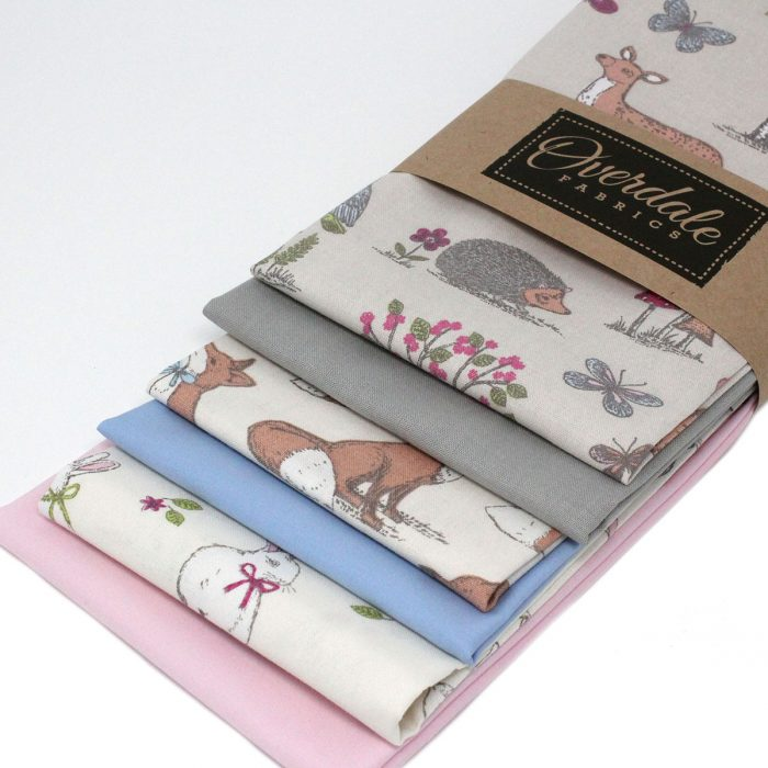 Fat quarter pack with woodland animals in pastel shades.
