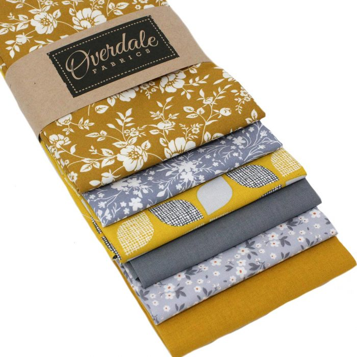Grey and mustard yellow fat quarter fabrics.