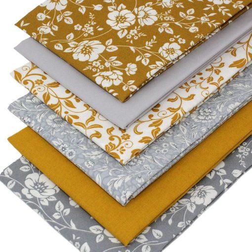 Mustard and grey fat quarter fabrics featuring flowers.