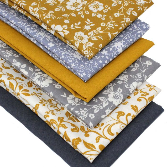 Fat quarter fabrics in mustard and grey.
