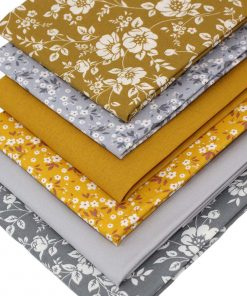 Floral fat quarter fabrics in mustard yellow and grey.