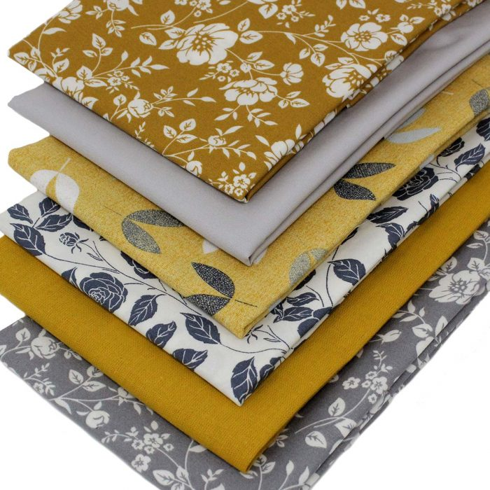 Mustard and grey fat quarters.