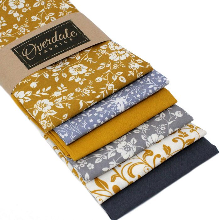 Mustard yellow and grey fabrics with a floral theme.