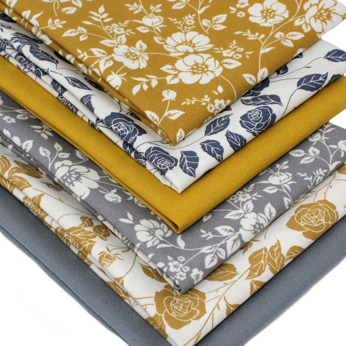 Floral prints in mustard yellow and grey.