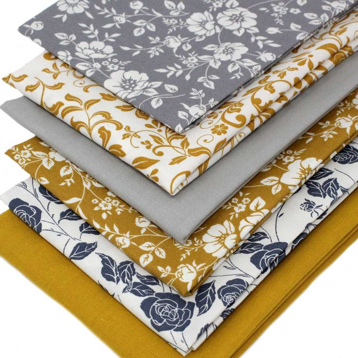 mustard yellow and grey floral fabrics.