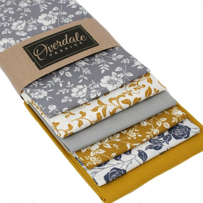 Yellow ochre and grey fat quarter fabrics.