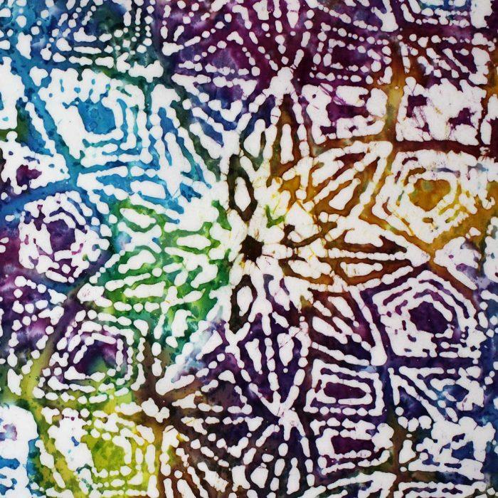 Vibrant star burst batik fabric design.