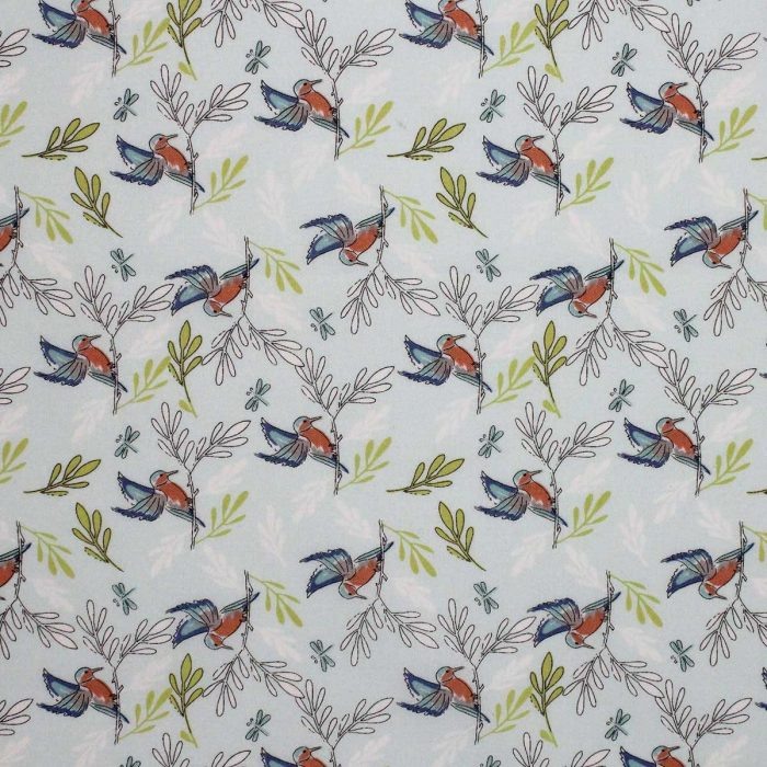 kingfisher design fabric on green