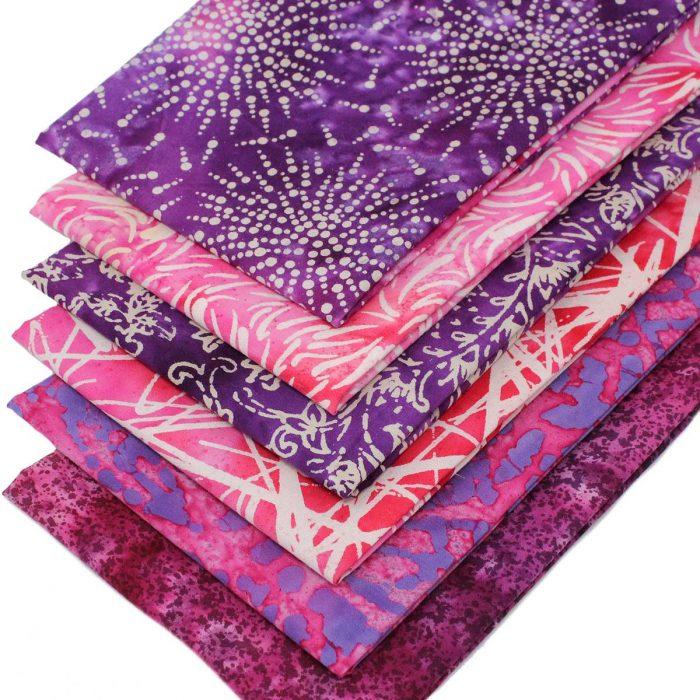 Batik fat quarters in pink and purple.