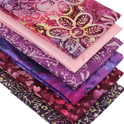 Batik fabrics in shades of pink and purple.