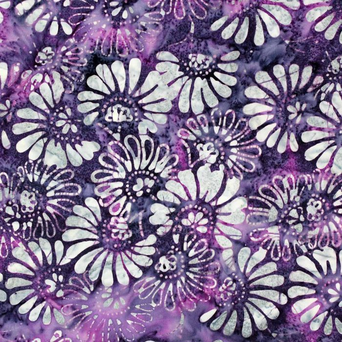 Deep purple batik fabric with a floral design.