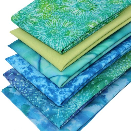 Fat quarter fabrics in blue and green including batiks.