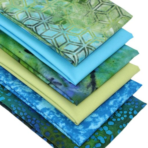 Fabrics in shades of blue and green including plain solids and batiks.