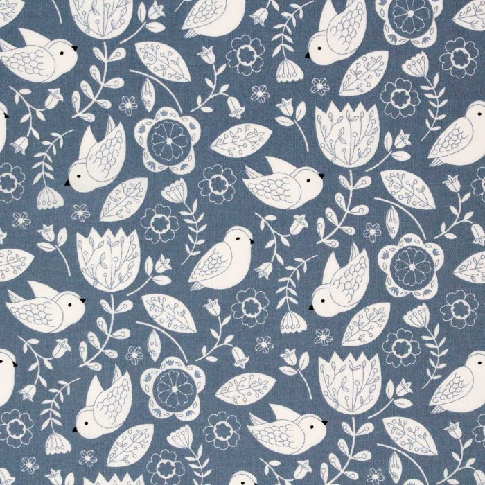 Airforce blue printed fabric of stylised birds and flowers.