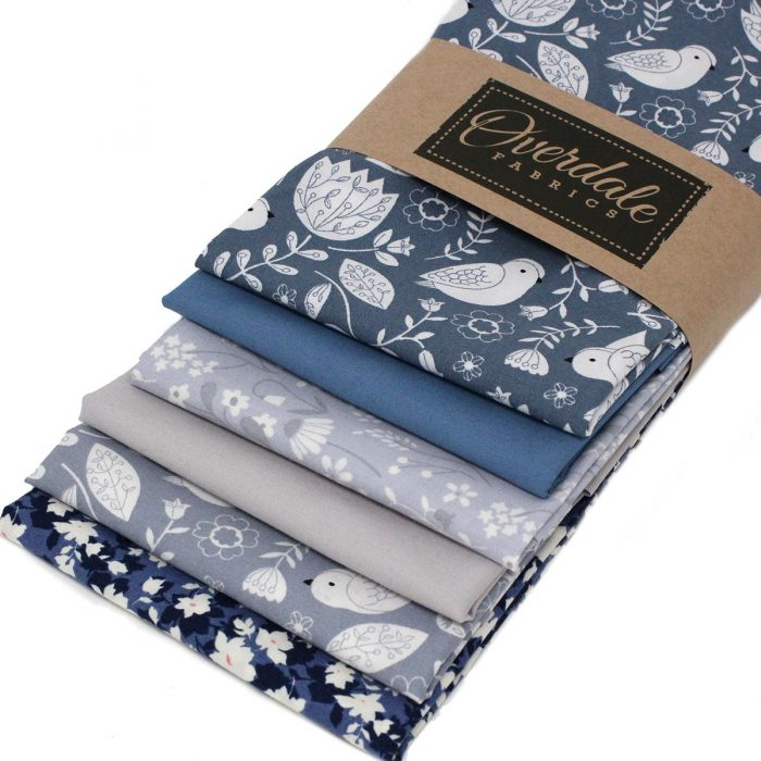 Blue and grey fat quarter fabrics with a bird theme.