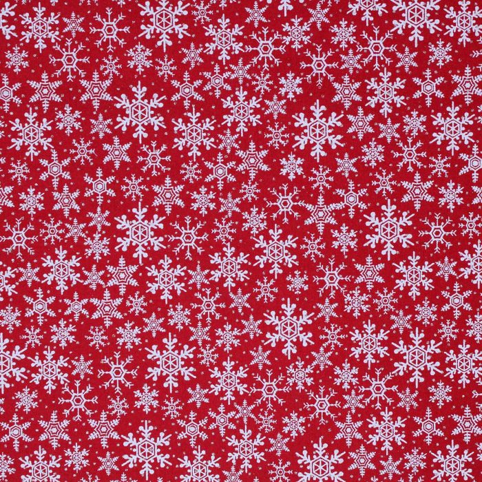 Red fabric with white and silver snowflakes.