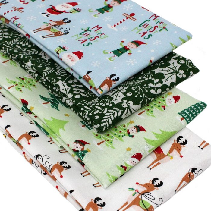Christmas fat quarter pack of jolly characters including reindeer, santa and elves