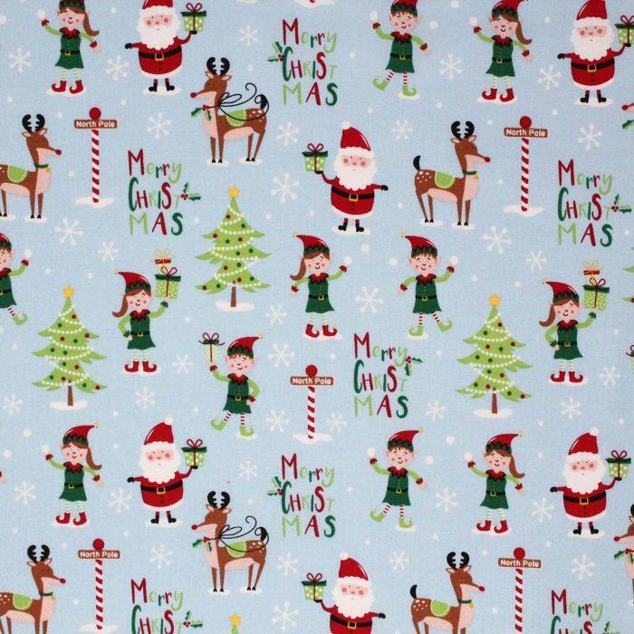 Fabric with a North pole fun festive scene.