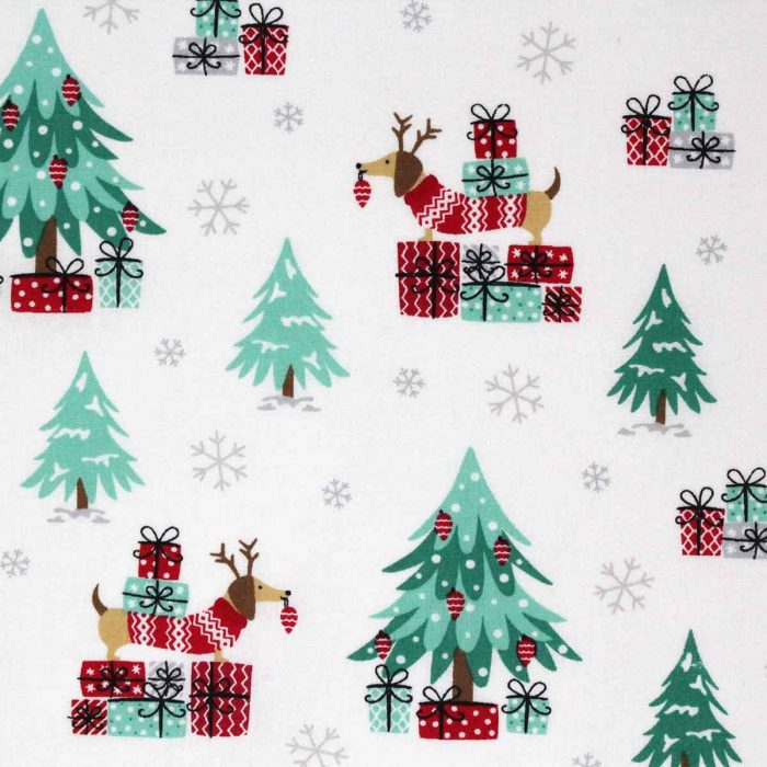 Christmas trees, parcels and Dachshund dogs on a printed fabric.
